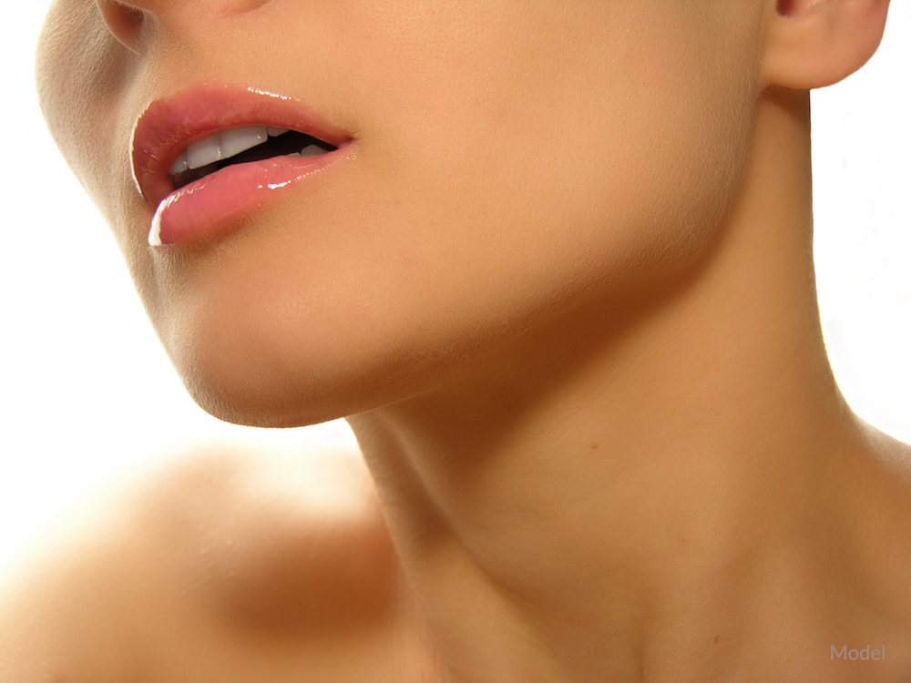 Close up image of a woman's contoured jawline.